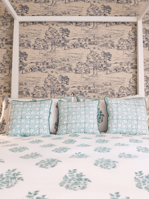 Green Heritage duvet set on bed with 3 contrast Heritage cushions
