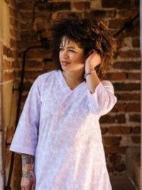 Natalie wearing Munnar Violet organic cotton tunic