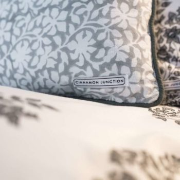 Close up of Grey Heritage block printed cushion cover on top of Heritage duvet set