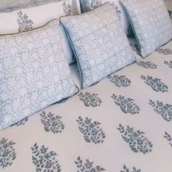 Close up of Heritage Grey duvet set and matching cushions