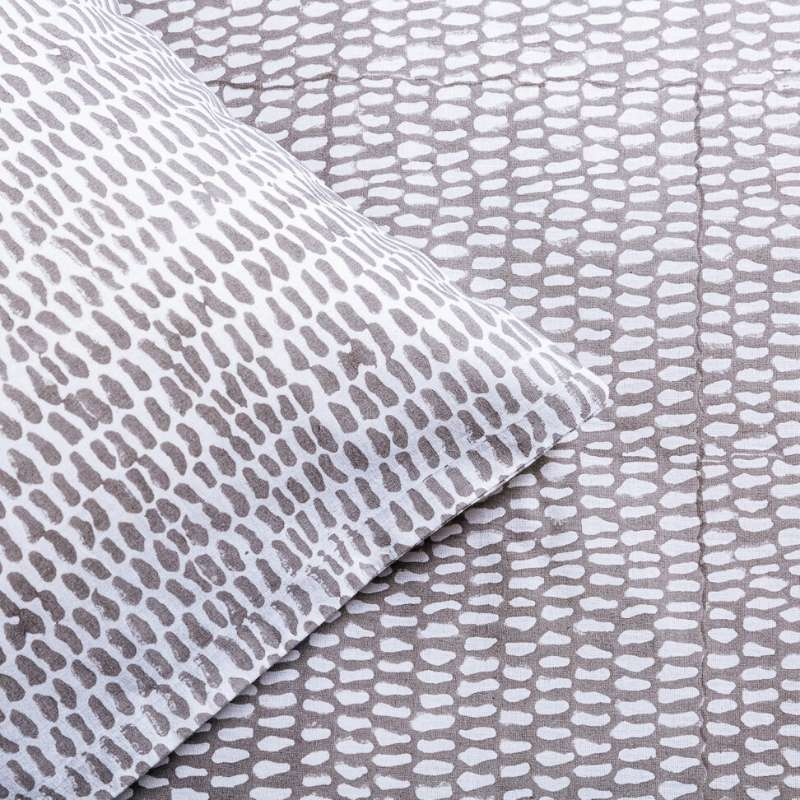Detail of contrasting pattern of Turtle Dove Grey Monsoon bed linen