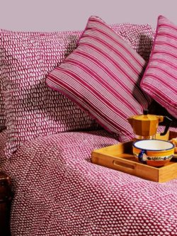 Raspberry Monsoon duvet set with breakfast coffee tray against a dusky pink wall