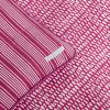 Detail of reversible Raspberry Monsoon block printed duvet cover