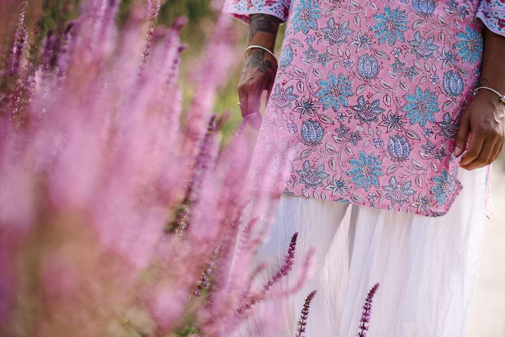 Detail of Maharani tunic behind a lavender bush in a sunny garden