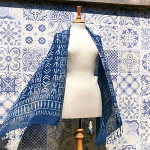 Cartouche Indigo Block Printed Scarf on a mannequin, blowing in the breeze