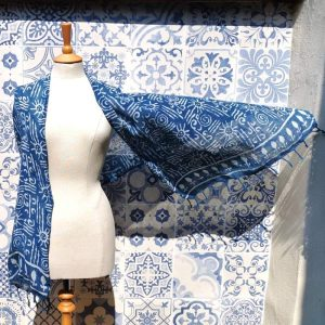 Sunshine Handwoven Indigo Blue Scarf draped on a mannequin, blowing in the wind