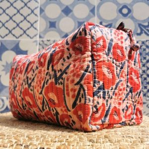 Close up of a side view of the Poppy organic cotton quilted wash bag